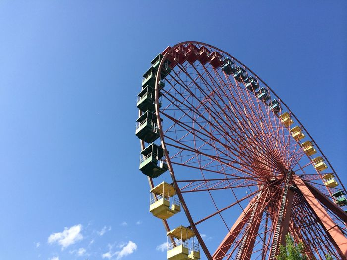 Low Angle View Of Cropped Ferries Wheel Against Blue Sky
