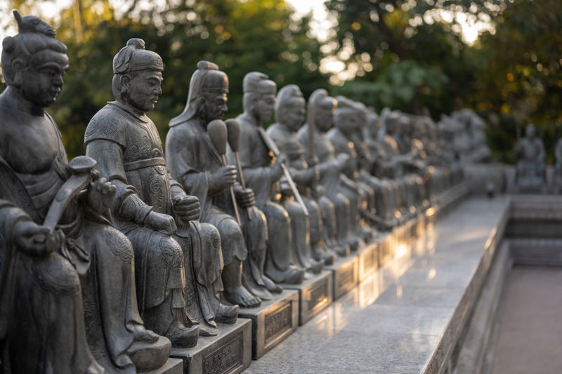 Sculpture of buddha statue in row