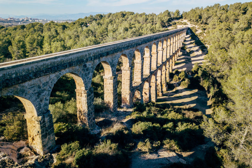 Aqueduct DJI X Eyeem Drone  The Ferreres Aqueduct Aerial Aerial View Architecture Bridge Bridge - Man Made Structure Built Structure Connection Day Dronephotography History Landscape Nature No People Old Outdoors Sky Sunlight Tree