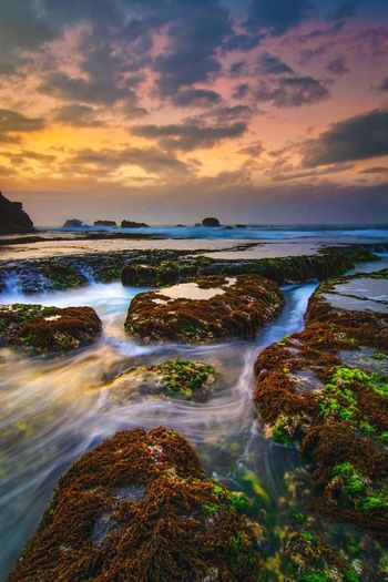 Motion at ranca buaya beach Water Low Tide Sea Waterfall Sunset Beach Wave Beauty Motion Sand Double Rainbow Romantic Sky Stream Dramatic Sky Calm Rainbow Moody Sky Forked Lightning Storm Cloud Seaweed Seascape Sky Only Surf Flowing Water Atmospheric Mood Tide Flowing Marram Grass