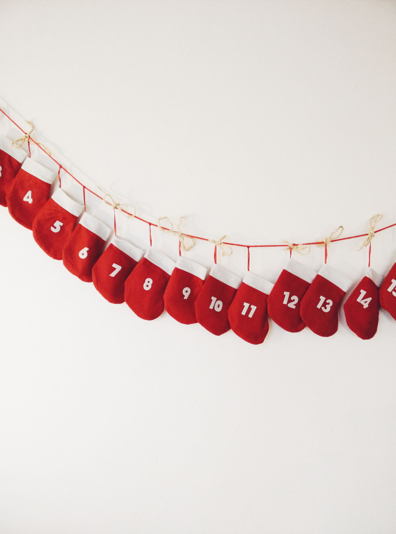 Christmas stockings in row with numbers