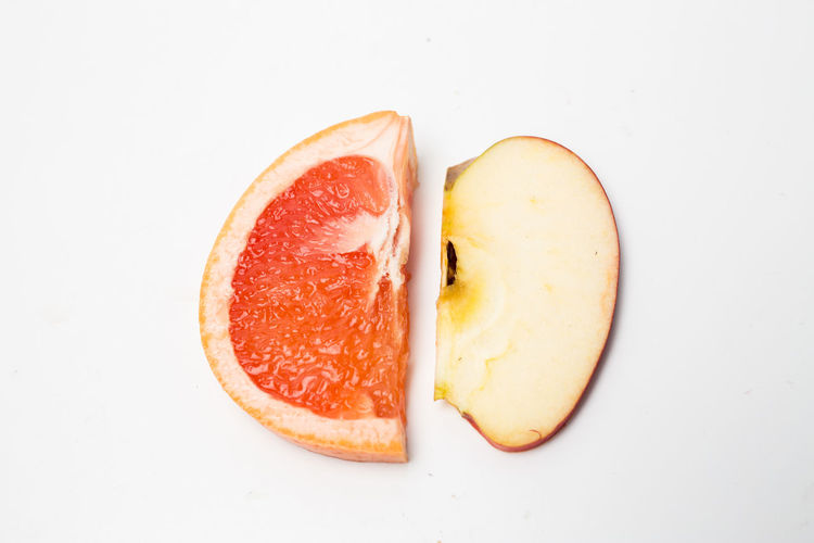 Food Fruit Studio Shot Food And Drink Healthy Eating Wellbeing White Background Freshness Indoors  Still Life SLICE Cut Out Close-up No People Cross Section Citrus Fruit Copy Space High Angle View Orange Color Directly Above Orange Ripe Breakfast Passion Fruit