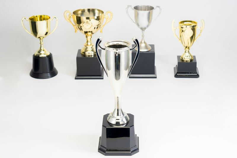 Variety of Trophy Cup on white background Trophy AWARD Success Winning Achievement Shiny Still Life Pride No People Silver Colored Indoors  Studio Shot Sport Gold Colored Competition Medal White Background Cut Out Close-up