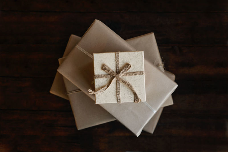 Top view stack of many xmas gift boxes wrapped in recycled kraft paper. eco-friendly, sustainable,