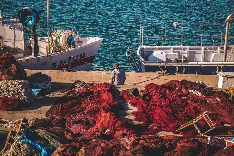 A fisherman resting Day Fisherman Fishing Fishing Industry Fishing Net High Angle View Men Mode Of Transport Nature Nautical Vessel Occupation One Person Outdoors People Real People Sea Transportation Water Working