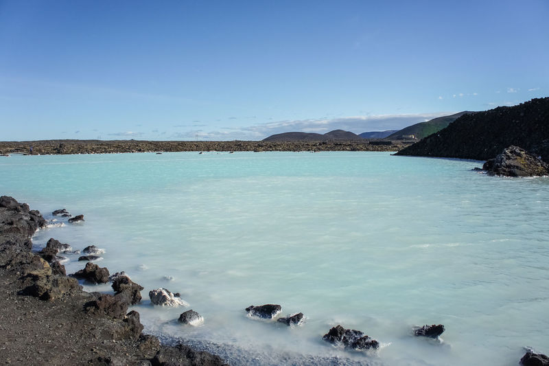 Rocks and blue water in Blue Lagoon, Iceland. Blue Lagoon Blue Lagoon Iceland Iceland Reykjavik Beauty In Nature Blue Blue Water Blue Water Blue Sky Clear Sky Day Geothermal Spa Lake Mountain Nature No People Outdoors Rock - Object Rocks Scenics Sky Tranquility Water