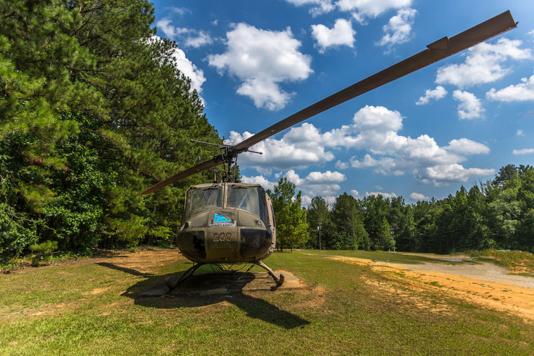 Retired U.S. Army Bell UH-1 Iroquois Blue Cloud Cloud - Sky Country Road Day Empty Field Grass Grassy Green Color Growth Landscape Mode Of Transport Nature No People Non-urban Scene Outdoors Plant Rural Scene Sky Stationary Sunlight Tranquil Scene Tranquility Tree