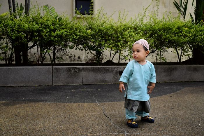 A little boy wearing 'Baju Melayu' a traditional Malay clothing for man. Traditional Clothing EyeEm Selects Full Length Childhood Child Standing Cute Babyhood Toddler