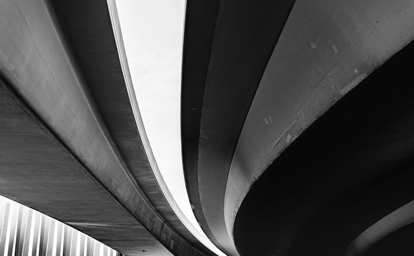 Low angle view of bridge against modern building