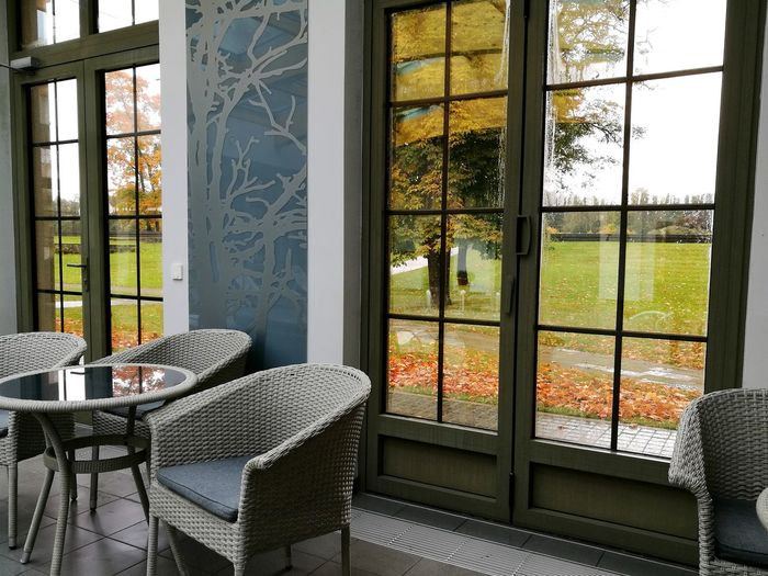 Window Looking Through Window No People Chair Indoors  Day Autumn Colors Fall Colors Autumn On The Table autumn through windows Enjoying Life Enjoy Colors Sundayvibes autumn outside Look Around