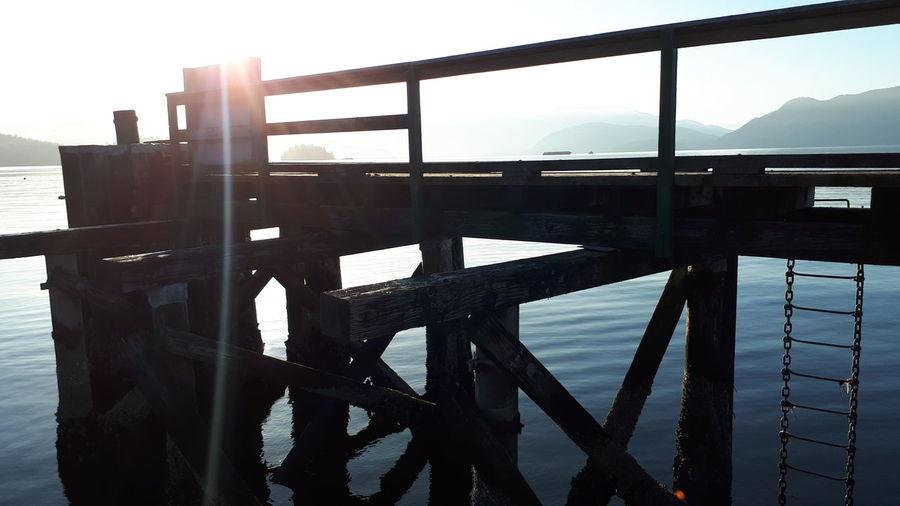 Summer is waiting Swimming Dock Jump Vacation Cabin Lake Summer Memories 🌄 Childhood Chain Ladder Ladder Pier Ocean Water Sea Clear Sky Bridge - Man Made Structure Sunlight Silhouette Railing Calm Stairs Sun