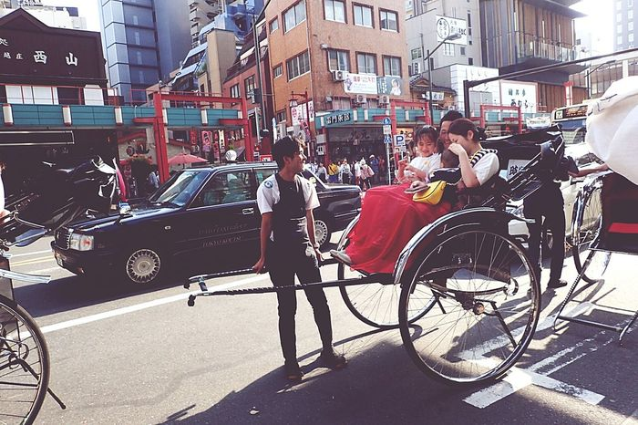 Kinda like this picture of a young family getting ready for their rickshaw tour. Wonder how heavy they amounted to and this rickshaw driver seemed so at ease. Reckon some of them are uni. students from the Dept. of Tourism studies.... #anjactyo2016 #rickshawdriver #rickshawdrivers #asakusa #japantrip japantravel. Ultimate Japan Asakusa Streetsoftokyo Tokyo Street Photography Tokyo Taitoku Japan Japanese  Rickshaw Rickshaw Puller Rickshawride Vehicle Nostalgic  Family Bonding Tourism Tourist Tourist Attraction  Happy Tokyo Street Scenes Transportation Old Transport Fine Art Photography The Street Photographer - 2017 EyeEm Awards Summer Road Tripping