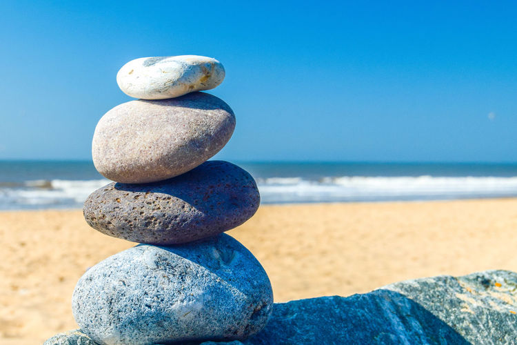 Pebble Stack Pebble Stacking Solid Stone - Object Rock Stone Land Beach No People Rock - Object Pebble Zen-like Nature Balance Stack Outdoors Sea Horizon Sky Water Horizon Over Water Tranquility Blue Scenics - Nature Stack Rock Space For Text Space For Copy Beach Photography