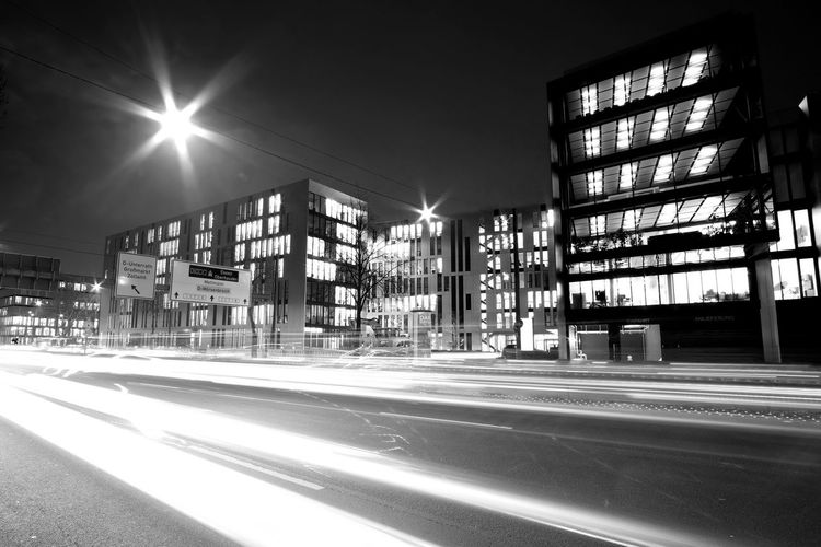 A street scene on a croudy street in Düsseldorf. Architecture Black And White Building Exterior City City Life Illuminated Long Exposure Motion Night No People Outdoors Road Sky Transportation Fujifilm_xseries FUJIFILM X-T2 The Week On Eyem Welcome To Black
