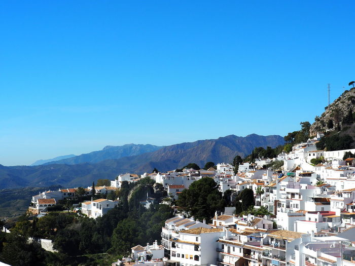SPAIN Mijas Mijas Pueblo TOWNSCAPE Cityscape Outdoors House Beauty In Nature Town Sunlight No People Day Mountain Range Tree Nature City Blue Clear Sky Residential District Sky Building Mountain Built Structure Architecture Building Exterior