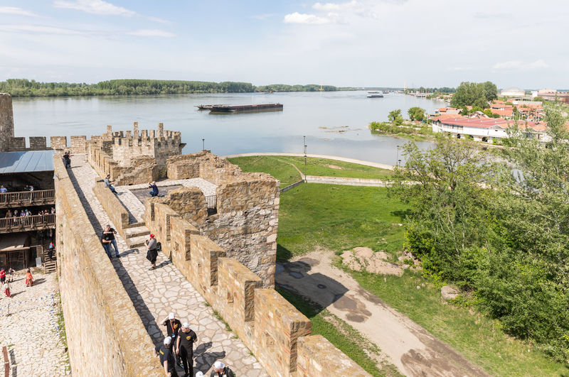 Smederevo, Serbia, May 03, 2019 : The remains of the fortress wall and the clock tower in the ruins of the Smederevo fortress, standing on the banks of the Danube River in Smederevo town in Serbia. Architecture Day Smederevo Serbia Castle Heritage Monument Fortress Wall Europe Medieval Architecture Historical Building Tower Sky Travel Destinations Fortification Wall Military Famous Place Ancient Architecture National Construction Culture And Tradition Strength Landmark Protection Knight