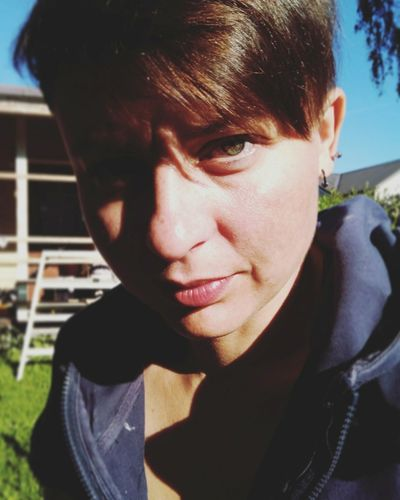 There Is Something To Do... Serious Portrait One Person Shadow Oneplus3T Sunny Day Adult Polishwoman Shorthair Pixiecut Green Eyes