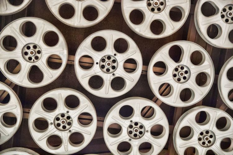 Backgrounds Geometric Shape Circle Full Frame Shape Film Reel Indoors  No People Large Group Of Objects Pattern Film Industry Rolled Up Close-up Design Film MOVIE In A Row Abundance