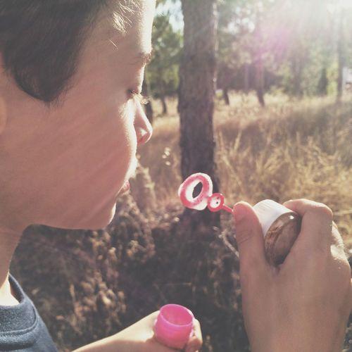 Kid blowing bubbles