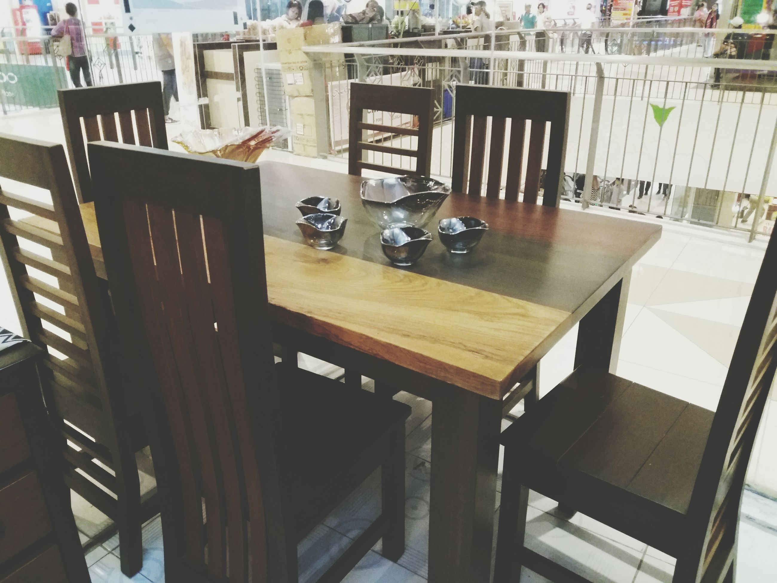 table, indoors, chair, absence, food and drink, empty, place setting, group of objects, restaurant, day, no people, modern, arrangement