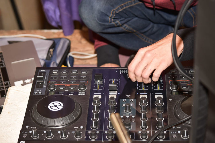 Midsection Of Dj Playing Music
