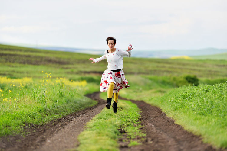 Gorgeous, beautiful young woman running on a countryside road. Freedom concept Adult Free Freedom Happy Happy :) Happy People Nature Road Running Woman Young Active Cheerful Conceptual Countryside Escape From The City Female Free As A Bird Girl Gorgeous Instagram Filter Outdoors Sexygirl Skirt Toned