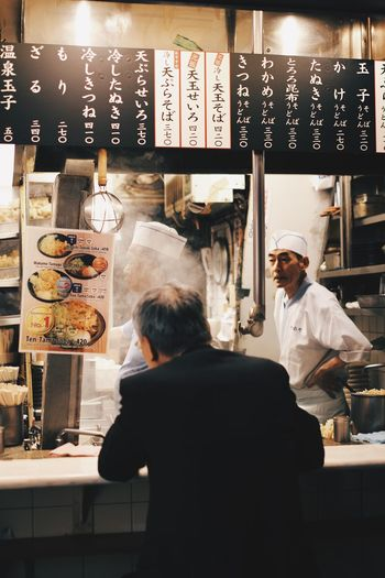 Rear view of people working at restaurant