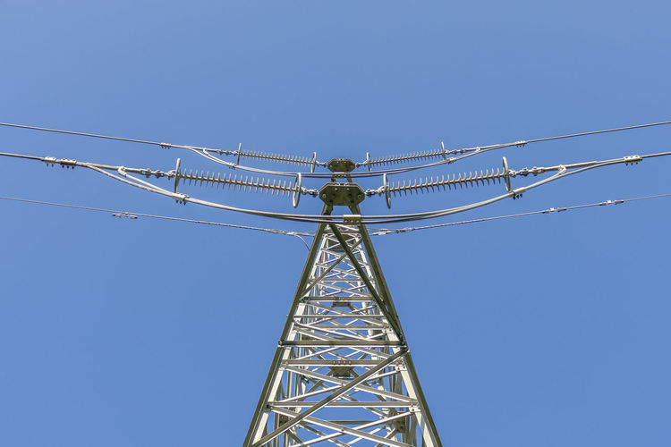 Sky Blue Low Angle View Clear Sky Nature Connection Metal Day No People Cable Electricity  Technology Power Supply Outdoors Copy Space Electricity Pylon Fuel And Power Generation Power Line  Built Structure Tall - High Electrical Equipment