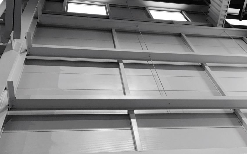 Low Angle View Architecture Built Structure Building Window No People Building Exterior Glass - Material Day Modern Railing Direction Technology In A Row Transportation Reflection Outdoors Lighting Equipment City