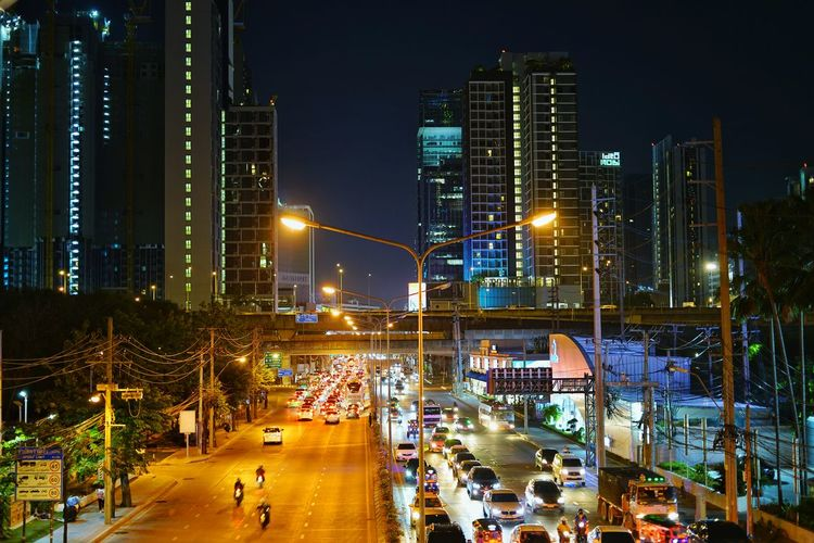 High angle view of illuminated street and buildings at night