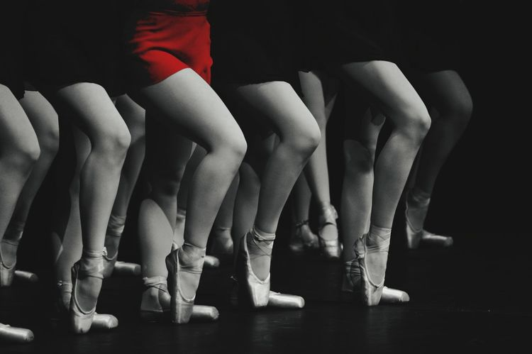 Performance Performing Arts Event Skill  Dancer Dancing Arts Culture And Entertainment Indoors  Ballet Ballet Dancer Coordination Adults Only Adult People Human Body Part Only Women Togetherness Low Section Young Adult Day Red