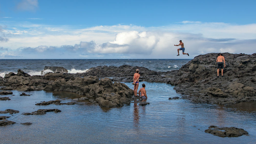 Tourists having fun at the natural pool on the north shore of Maui. Beach Blue Day Full Length Fun Hawaii Jumping Maui Nature Outdoors Pacific Ocean People Scenics Sea Sky Vacations Water Enjoy The New Normal Live For The Story