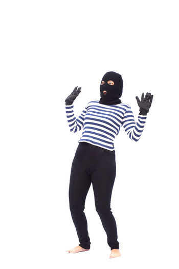 Bandit Give Up Adult Casual Clothing Cut Out Day Front View Full Length Happiness Lifestyles One Person People Portrait Real People Standing Striped Studio Shot Thief White Background Young Adult Young Women
