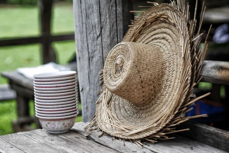 Close-up of bowls and hats on table