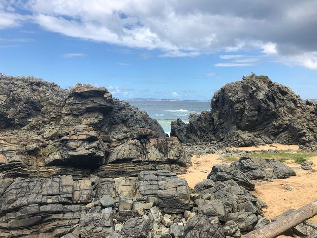 Sky Cloud - Sky Nature Rock Tranquility Beauty In Nature Scenics - Nature Outdoors Rock Formation No People Solid Water Rock - Object Sunlight Beach Day Tranquil Scene Land Sea Architecture