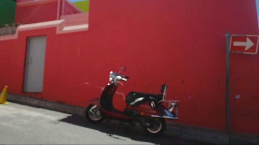 Land Vehicle Transportation Mode Of Transport Built Structure Building Exterior Architecture Day Outdoors Red Scooter No People Motorcycle