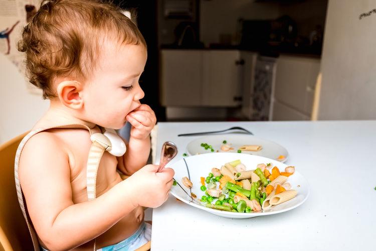 Girl eating food on table