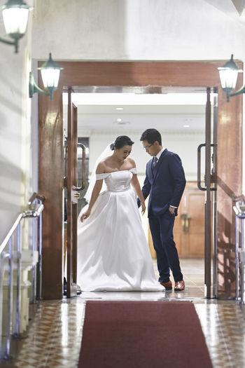 Bride and groom seen through doorway