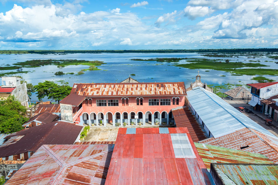 View of Iquitos, Peru with the Itaya River in the background in the Amazon Rainforest. Iquitos is the largest city in the world with no road connection. Amazon Amazonas America Background Brazil City Day Forest Iquitos  Jungle Landscape Largest Nature Nature Outdoors Peru Peruvian Rainforest River South Travel Tropical View Water World