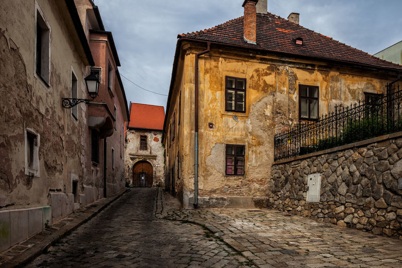 City of Bratislava in Slovakia, street and aged houses in the Old Town. Bratislava Slovakia Europe Architecture Built Structure Building Exterior Building The Way Forward Cobblestone City Street Town Old House Alley Stone Wall No People Grunge Aged Atmospheric Mood Cobbled Old Buildings Travel Destinations Capital Cities  Historical Building