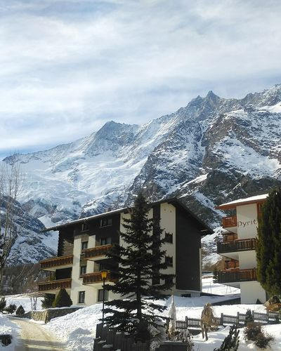 Architecture Building Exterior Cold Temperature Snow House No People Outdoors Winter Snowy Mountains Switzerland Swiss Mountains Saasfee Cloud - Sky Travel Destinations Mountain Sky Built Structure