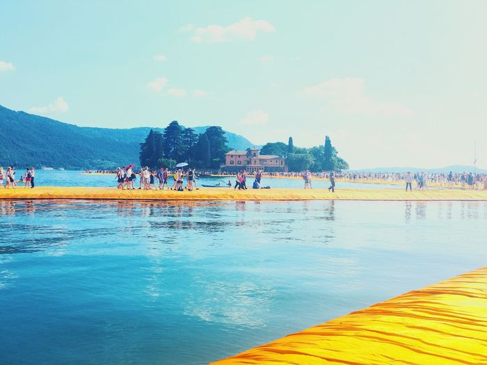 Water Sky Cloud - Sky Reflection Tranquility Outdoors Tourist Resort Travel Destinations Scenics Nature Mountain The Floating Piers The Floating Piers By Christo Christo Installation Installation Art Installazione Happiness Hot Weather Lago D'Iseo