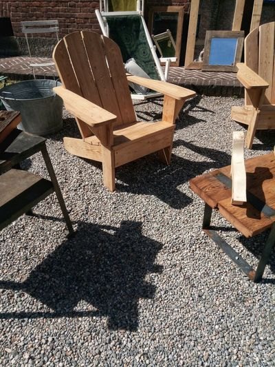 High angle view of empty chairs and table in yard