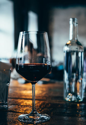 glass of red wine in a bar Alcohol Close-up Day Drink Focus On Foreground Food And Drink Freshness Half Full Indoors  No People Red Wine Table Wine Winebar Wineglass Winetasting Wine Not