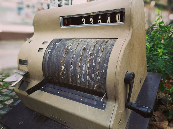 Close-up of old machine part
