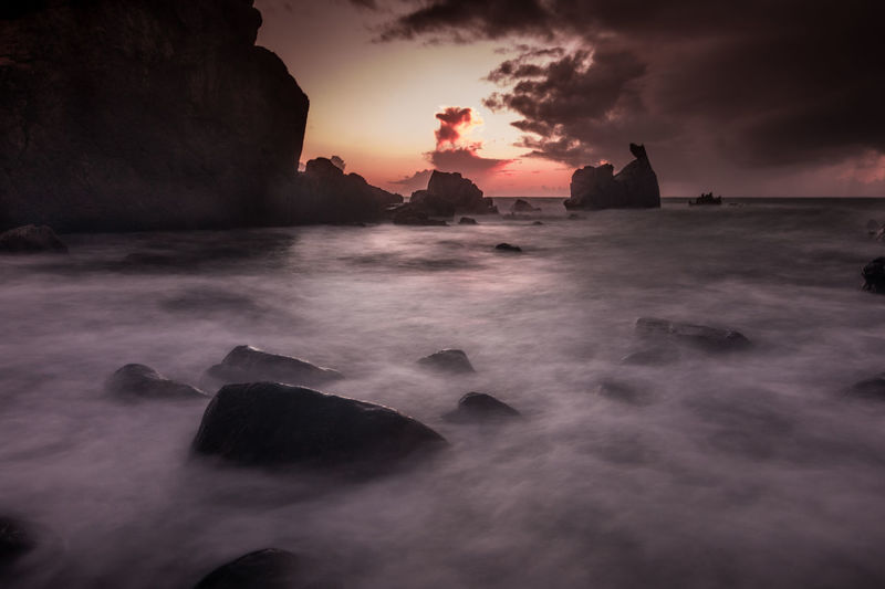 The redish sunset Beauty In Nature Cliff Cloud - Sky Day Horizon Over Water Long Exposure Motion Mystery Nature No People Outdoors Power In Nature Rock - Object Rock Formation Scenics Sea Sky Sunset Water Wave