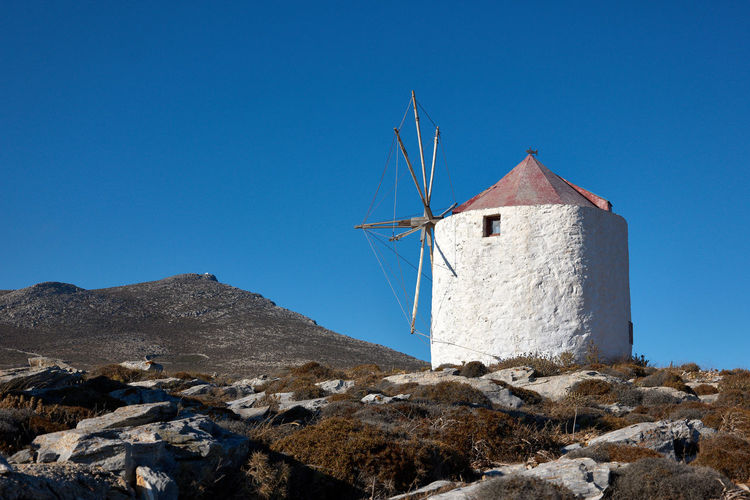 Amorgos Windmill Windmill Amorgos Amorgos Chora Architecture Blue Building Exterior Built Structure Clear Sky Copy Space Day Environment Fuel And Power Generation Greece Mountain Nature No People Outdoors Rock Rock - Object Scenics - Nature Sky Solid Turbine Wind Power Wind Turbine