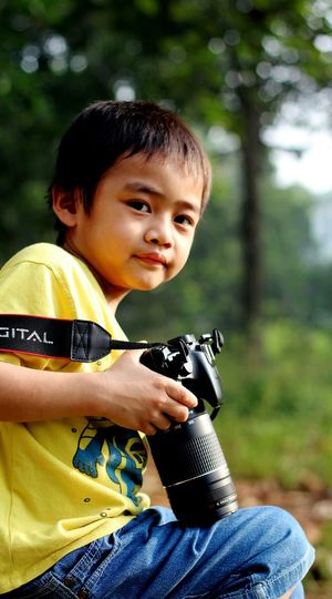EyeEm Selects Child Childhood One Person People Males  Boys One Boy Only Children Only Holding Cute Portrait Smiling Outdoors Watching Forest Day Sitting Cheerful Weapon Tree MySON♥ Ezzra Canonphotography Take Photos