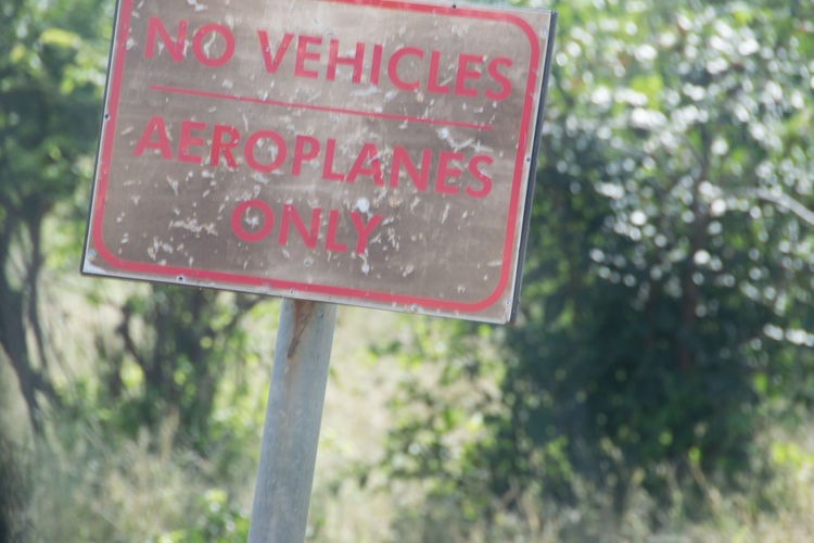 Aeroplanes Only Africa Child Children Luangwa Outdoors Portrait Sign Text Unusual Signs Zambia
