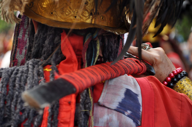 from behind ASIA INDONESIA Capgomeh Minahasa INDONESIA Manado Warriors Sword Traditional Clothing Tradition People One Person Focus On Foreground Traditional Festival Outdoors Day Close-up